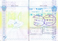 Passport with stamps of Kyrgyzstan, Kazakhstan and Uzbekistan Royalty Free Stock Image
