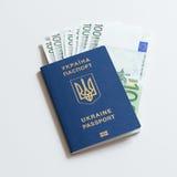 Ukrainian passport for travel abroad of euro banknotes. abolition of Schengen visas for Ukrainian - concept Stock Images