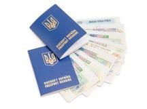 Ukrainian passports on a background of travel visas Stock Photo