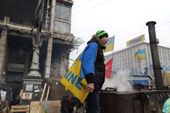 Ukrainian patriotic cook on duty. KYIV, UKRAINE - MARCH 02, 2014: Young man stands on the top of field cooker in the Kiev's central Independence Square during Stock Photo