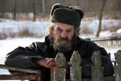 Ukrainian peasant. Portrait of a elderly man in winter hat Royalty Free Stock Photos