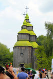 Ukrainian people near wooden orthodox church in Museum Pirogovo, Stock Images