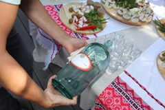 The Ukrainian people`s national alcoholic drink - moonshine liquor and vodka and snacks, canapes. At the presentation of the menu of Ukrainian national cuisine stock images