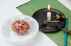 Ukrainian pisanka with a tool, candle, piece of wax Royalty Free Stock Photography