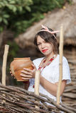 Ukrainian pregnant woman in traditional embroidered shirt Stock Photography