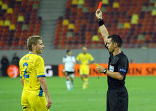 Ukrainian referee Yaroslav Kozyk shows red card Stock Images