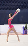 Ukrainian Rhythmic Gymnastics Championship 2014. Uzhgorod, Ukraine-August 2, 2014: Ganna Rizatdinova of Ukraine performs ball during the individual ball royalty free stock photo