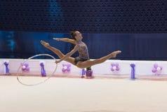 Ukrainian Rhythmic Gymnastics Championship 2014. Uzhgorod, Ukraine-August 2, 2014: Ganna Rizatdinova of Ukraine performs hoop during the individual ball royalty free stock photo