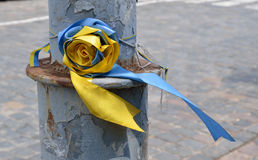 Ukrainian ribbons on the post peeled Royalty Free Stock Photo