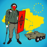 Ukrainian right quadrant party man. Radical revolutionary shield and armored troop carrier Stock Photo