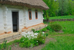Ukrainian rural house with a straw roof Royalty Free Stock Photography