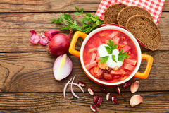Ukrainian and Russian national Red Borsch. With Bread closeup on Old Wooden Surface. Spices royalty free stock image