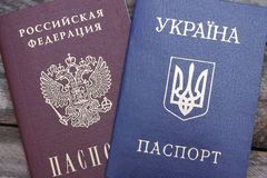 Ukrainian and Russian passports. On the background of wood Royalty Free Stock Images