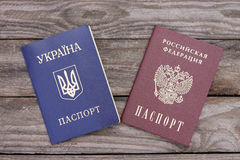 Ukrainian and Russian passports. On the background of wood Stock Photo