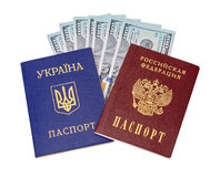 Ukrainian, Russian passports and  dollar bills Royalty Free Stock Photos