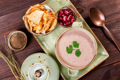 Ukrainian and Russian traditional beetroot soup - borscht in clay pot with sour cream, bread on dark wooden background. Ukrainian and Russian traditional Stock Photography