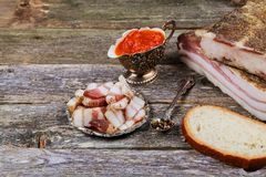 Ukrainian salo served with mustard, top view. Background of rustic wooden Royalty Free Stock Images
