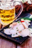 Ukrainian salted fat with beer and croutons with garlic on a wooden tray. Stock Photography