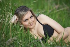 Ukrainian sexy girl in green grass Royalty Free Stock Photography