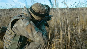 Ukrainian soldier takes aim. Back view. The goal is not visible stock video footage