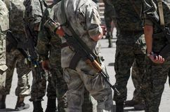 Ukrainian soldiers with machine-guns. Soldiers with machine-guns standing in line : war in Ukraine Stock Photography