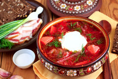 Ukrainian soup borsch. Hot borsch with brown bread, lard and chives royalty free stock photography
