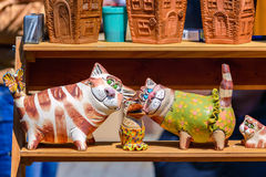Ukrainian souvenirs made of ceramics. Pottery. cats and crow Royalty Free Stock Photography