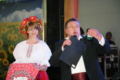 In the Ukrainian style. Beautiful girl actress animator in the national Ukrainian costume and Nikolay Y. Pozdeev - Entertainer. Performance in the restaurant of Royalty Free Stock Images