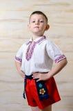 Ukrainian talented boy posing with raised arms Royalty Free Stock Photos