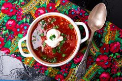 Ukrainian traditional borsch. Russian vegetarian red soup in white bowl on black background. Top view. Borscht, borshch with bee royalty free stock photography