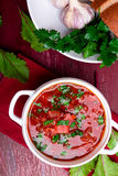 Ukrainian traditional borsch. Russian vegetarian red soup in white bowl on red wooden background. Top view. Borscht, borshch wit. H beet stock photos