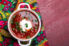Ukrainian traditional borsch. Russian vegetarian red soup in white bowl on red wooden background. Top view. Borscht, borshch wit royalty free stock photography