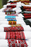 Ukrainian traditional embroide. Ukrainian traditional clothes with fine needle-work arranged in row Stock Photography