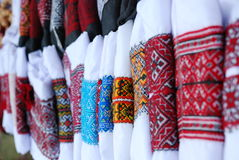 Ukrainian traditional embroidery. Ukrainian traditional clothes with fine needle-work arranged in row Stock Photo