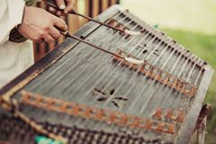 Ukrainian traditional music string instrument tsymbaly. Man wearing traditional clothes playing folk Ukrainian music. Close view Royalty Free Stock Photo