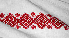 Ukrainian traditional needlecraft. Red embroidery pattern on white fabric, close-up Stock Photography