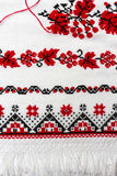Ukrainian traditional pattern of characters embroidered on the towel with red and black thread. Royalty Free Stock Photos