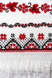 Ukrainian traditional pattern of characters embroidered on the towel with red and black thread. Stock Photo