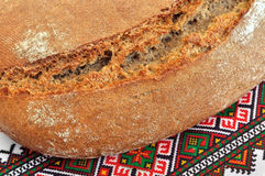 Ukrainian traditional rye bread. On ethnic embroidery background Royalty Free Stock Photo