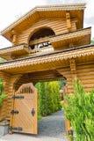 Ukrainian traditional wooden church gate. Ukrainian traditional orthodox wooden church gate in summer Stock Image