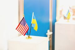 Ukrainian and USA flags stand together. Closed door on the background. Government negotiations. Partnership and. Cooperation concept Royalty Free Stock Images