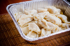 Ukrainian varenyky or perogies. In foil plate Royalty Free Stock Photo
