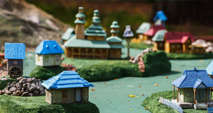 Ukrainian village with houses and a church in miniature Stock Photos