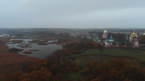 Convent on the Bank of the River, Swamp and Morning Mist. Ukrainian Village on the River Bank with a Church, Convent on the Bank of the River, Swamp and Morning stock video