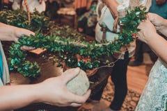 The Ukrainian wedding tradition is the bride`s wreath weaving stock photos
