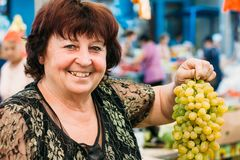 Ukrainian woman aged seller at local grocery Royalty Free Stock Photos