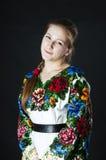 Ukrainian woman on black background Stock Photo