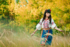 Ukrainian woman in national clothes on the wheat Royalty Free Stock Photo