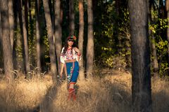 Ukrainian woman in national clothes on the wheat Stock Images