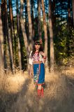 Ukrainian woman in national clothes on the wheat Royalty Free Stock Image